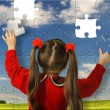 The girl assemble big puzzle — Stock Photo #2644911