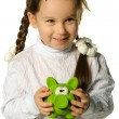 The little girl with a money box - a pig — Stock Photo