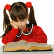 The little girl before the big book — Stock Photo