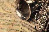 Old saxophone and notes — Stock Photo