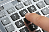 The calculator and a hand of the man — Stock Photo