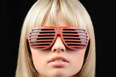 Girl in stylish sunglasses - jalousie — Stock Photo
