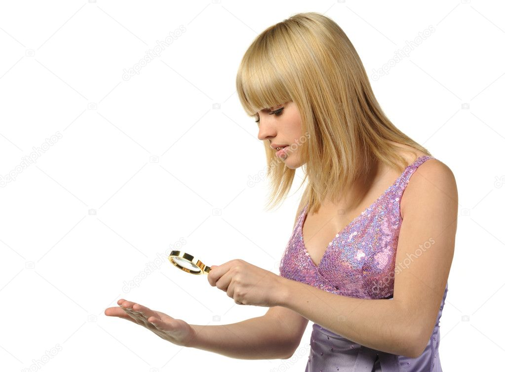 The girl looking at a hand through a magnifier. It is isolated on a white background — Stock Photo #2645387