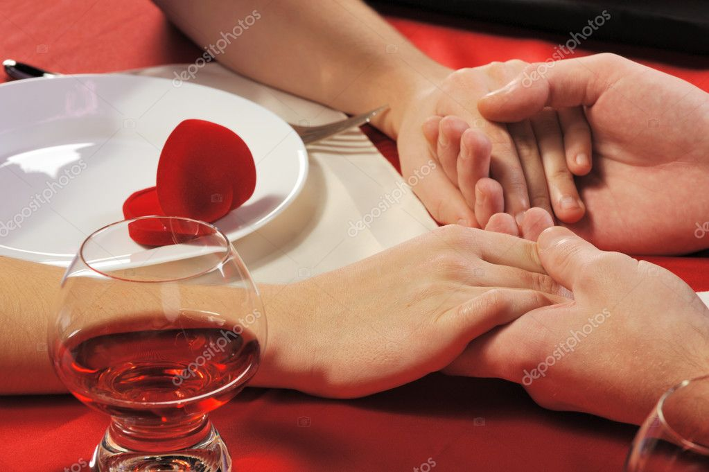 Romantic supper. A close up. Young the man does the offer to the girl. — Foto de Stock   #2647430