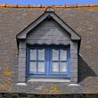 House with blue windows near Mont-Dol — Stock Photo #1767003