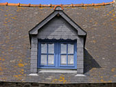 House with blue windows near Mont-Dol — Stock Photo