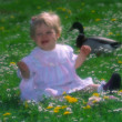 Happy Baby girl, meadow in spring — Stock Photo