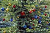 Christmas tree with glitterballs, German — Stock Photo