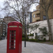 Red phone booth in London - Stock Photo