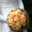 Bride bouquet with yellow orange roses — Stock Photo