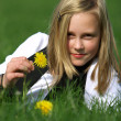 Blonde girl  lies in the grass — Stock Photo