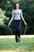 Young, sporty woman with skipping — Stockfoto