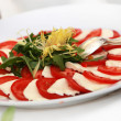 Tomatoes and mozarella — Stock Photo