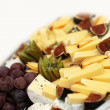 Cheese plate with grapes — 图库照片