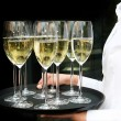 A waiter with champagne glasses - Stock Photo