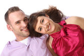 Young, happy couple lying on the floor — Stock Photo