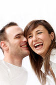 Happy, young couple laughing together — Stockfoto