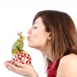 Young woman kissing a frog king — Stock Photo