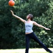 Woman playing with a ball — Foto de Stock