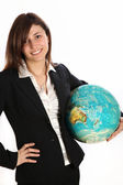 Woman carrying a globe under his arm. — Stock Photo