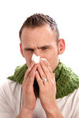 A sick man blows his nose. — Stock Photo