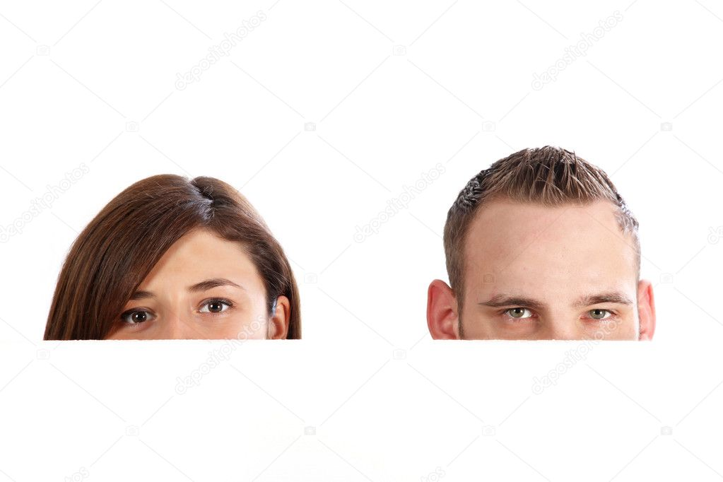 Young couple behind a wall, only the eyes are visible. With space for text — Stock Photo #2416365