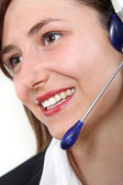 Young, friendly woman in the call center — Stock Photo