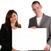 Couple keep unmarked, white sign — Stockfoto