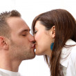 A young couple kissing. — Stock Photo