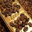 Gold coffee — Stock Photo #1678653