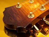 Gold guitar — Stock Photo