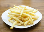 French fries on plate — Stock Photo