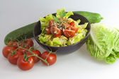 Salad with tomato cucumber cabbage — Stock Photo