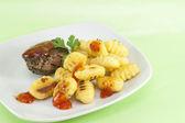 Pepper steak with gnocchi — Stock Photo