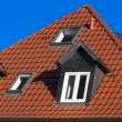 Royalty-Free Stock Photo: Red tiled roof under blue sky