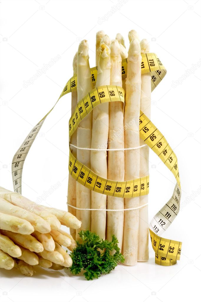 Fresh aspargus with tape measure on bright background — Stock Photo #1540959