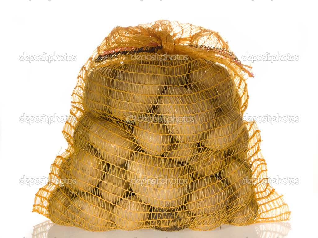 Potatoes in a sack on bright background — Stockfoto #1543884
