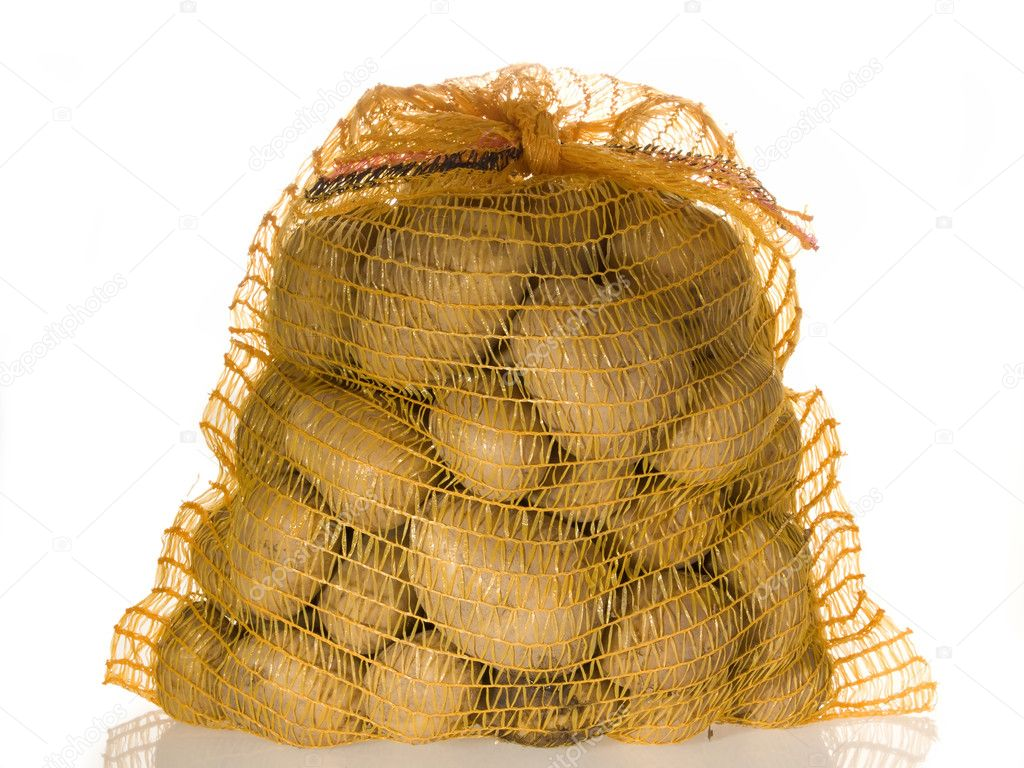 Potatoes in a sack on bright background — Foto Stock #1543884