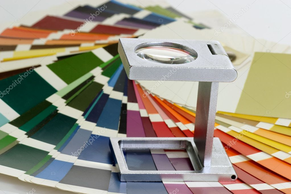 Characteristic image for the pre-press and printing industry. Linen tester withand colour sample. — Stock Photo #1543903