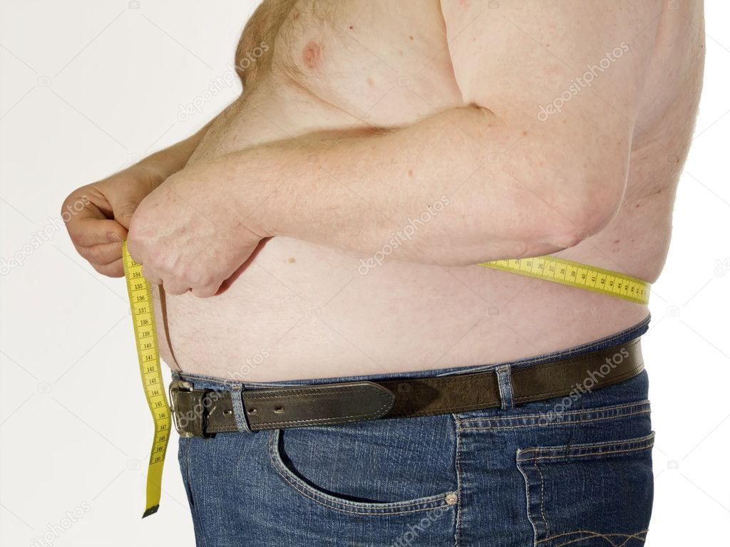 Fat man with no shirt and his belly hanging over his pants.  Stock Photo #1556206