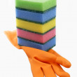 Rubber glove with sponges — Stock Photo