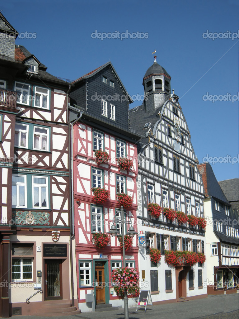 Historic building facades of Butzbach, Germany, with flowering window boxes, timber framing. — Stock Photo #1564551
