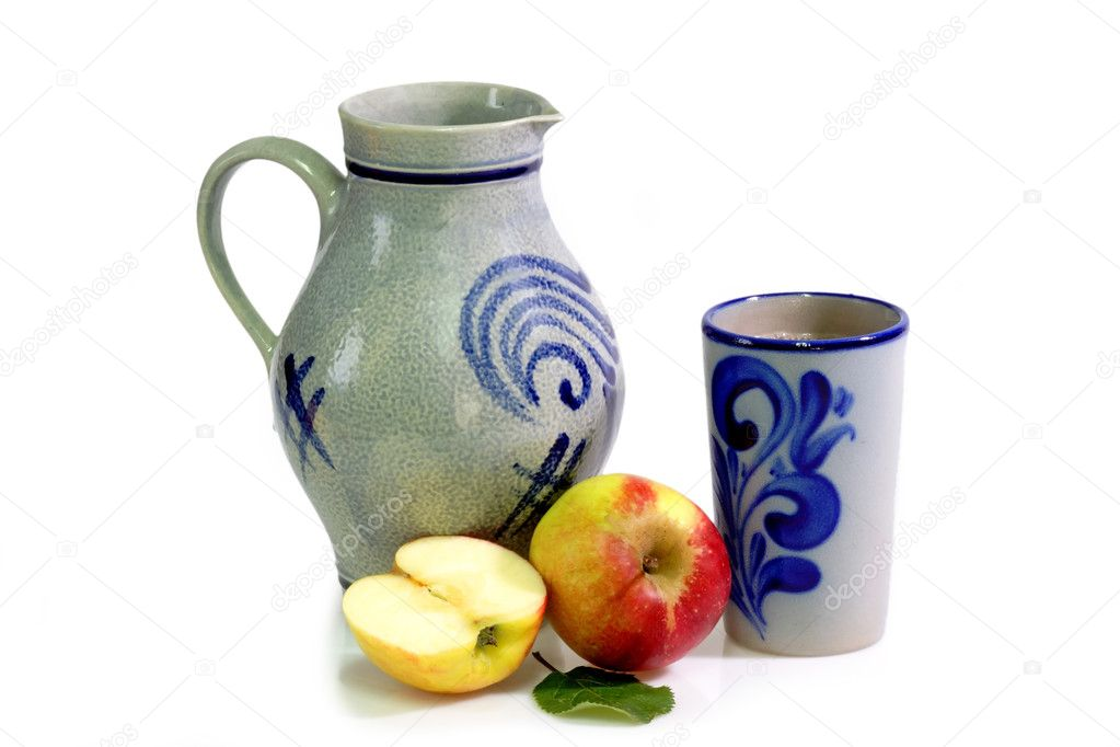 Clay jug with apples on bright background — Stock Photo #1569786