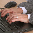 Typing on a keyboard — Stockfoto