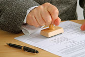 Stamping a document — Stock Photo