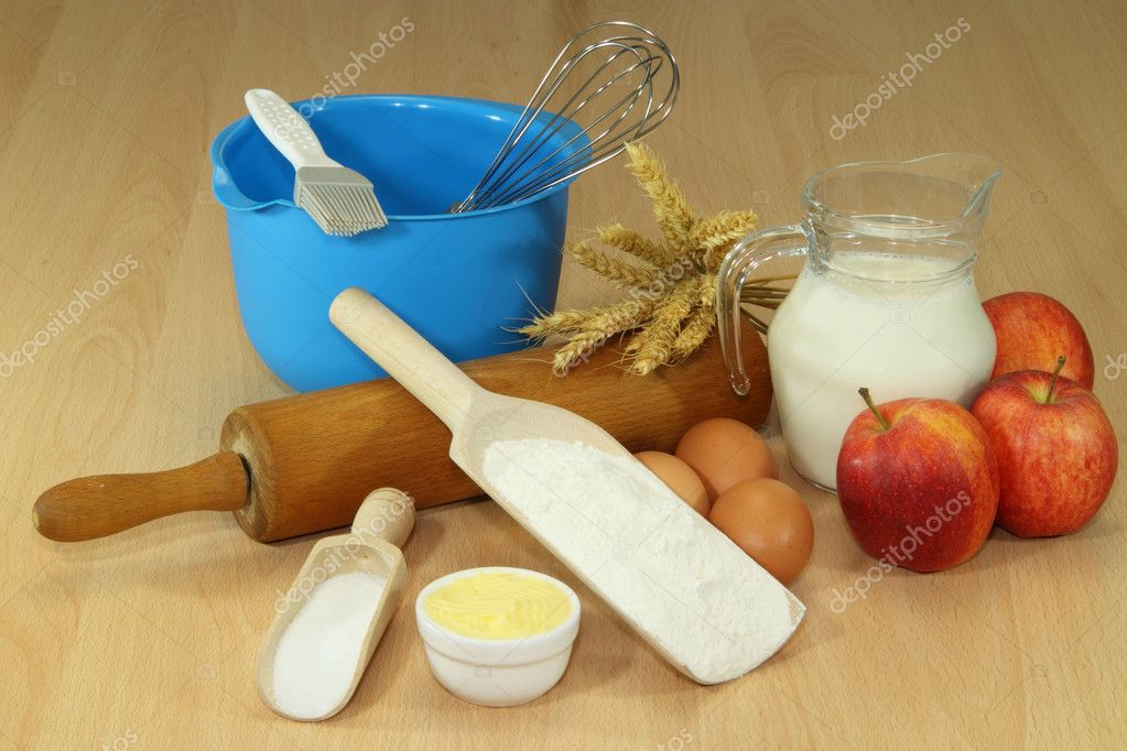 Baking ingredients on a brown kitchen board — Stock Photo #2553585