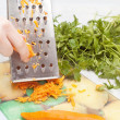 Grating carrot — Stock Photo