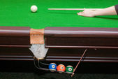 Pool table with balls in pocket — Stock Photo