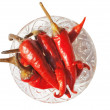Plate with red hot chili peppers — Stock Photo