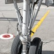 Airplane undercarriage - Stock Photo